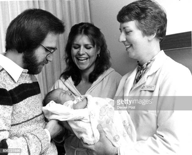 New parents Ron and Jannette Peterson prepare to leave Presbyterian Aurora Hospital with their 2dayold daughter Kristen With them is Toni Demattio...