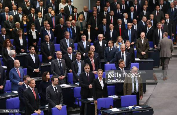 New parliamentarians of the rightwing Alternative for Germany here seen in the central and right side of the frame stand next to members of the...