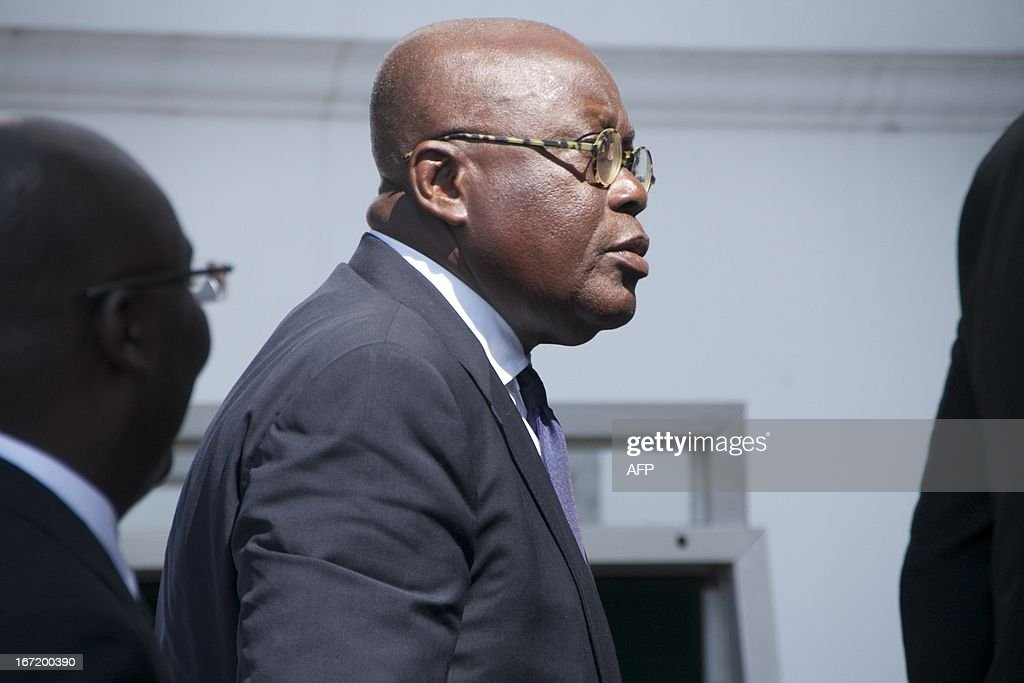 New Patriotic Party presidential candidate Nana AkufoAddo arrives on April 22 2013 at Ghana's Supreme Court in Accra Ghana's government on April 22...