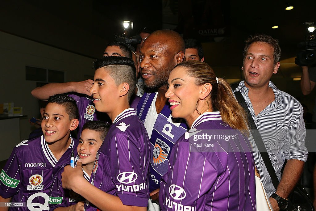 New Perth Glory A-League recruit William Gallas stops for photos with Glory supporters after arriving at Perth International Airport on November 9, 2013 in Perth, Australia.