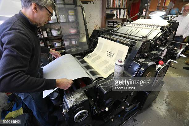 A new plate is loaded onto a Heidelberg offset and letterset press Coach House Press is a small books publisher The press is housed in a couple old...