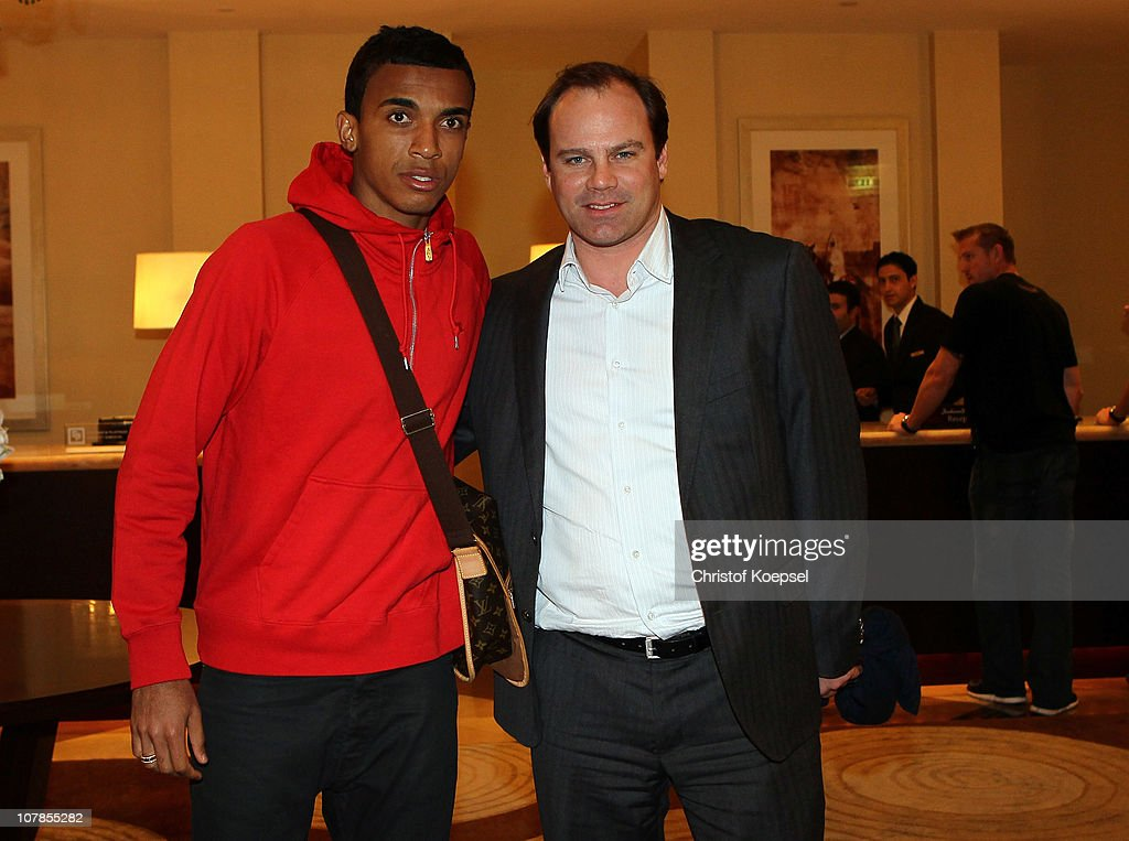 New player Luiz Gustavo (L) and manager <a gi-track='captionPersonalityLinkClicked' href=/galleries/search?phrase=Christian+Nerlinger&family=editorial&specificpeople=774347 ng-click='$event.stopPropagation()'>Christian Nerlinger</a> (R) arrive at the Hotel Grand Hyatt during the FC Bayern Muenchen training camp on January 3, 2011 in Doha, Qatar.