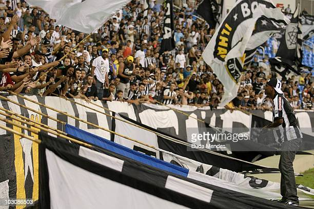 New player Maicosuel of Botafogo is presented to supporters before a match between Botafogo and Fluminense as part of Serie A at Engenhao Stadium on...