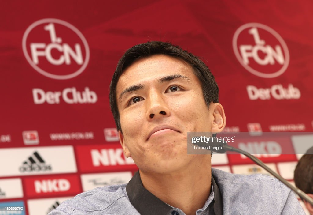 New Player Makoto Hasebe of FC Nuernberg smiles during a press conference at Sportpark Valznerweiher on September 12, 2013 in Nuremberg, Germany.