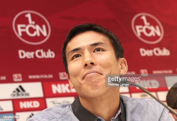 New Player Makoto Hasebe of FC Nuernberg smiles during a press conference at Sportpark Valznerweiher on September 12 2013 in Nuremberg Germany