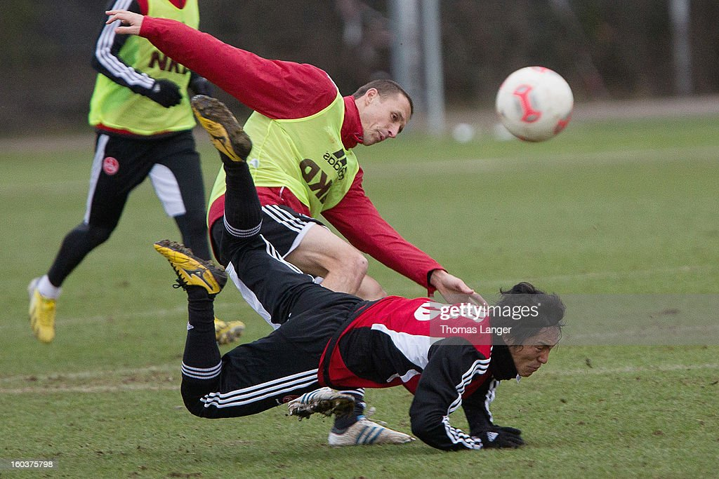 New player Mu Kanazaki of 1 FC Nuernberg and teammate Tommy Simons (L) compete for the ball during a training session on January 30, 2013 at the Sportpark Valznerweiher in Nuremberg, Germany.