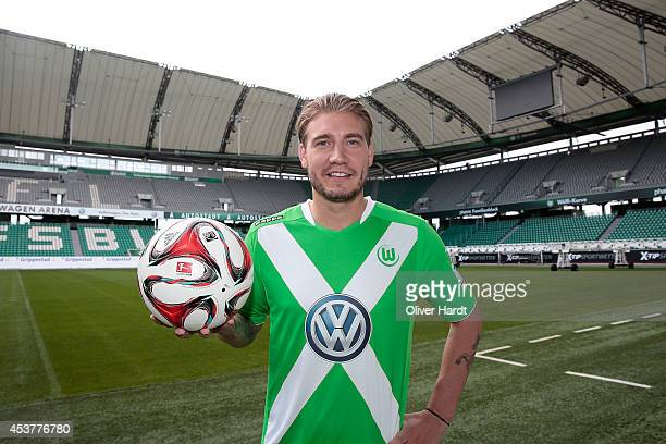 New Player Nicklas Bendtner of VfL Wolfsburg poses during a portrait session at Volkswagen Arena on August 15 2014 in Wolfsburg Germany