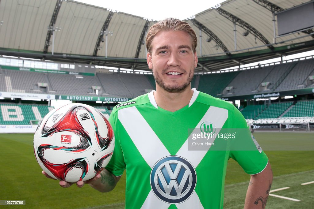 New Player <a gi-track='captionPersonalityLinkClicked' href=/galleries/search?phrase=Nicklas+Bendtner&family=editorial&specificpeople=2142069 ng-click='$event.stopPropagation()'>Nicklas Bendtner</a> of VfL Wolfsburg poses during a portrait session at Volkswagen Arena on August 15, 2014 in Wolfsburg, Germany.