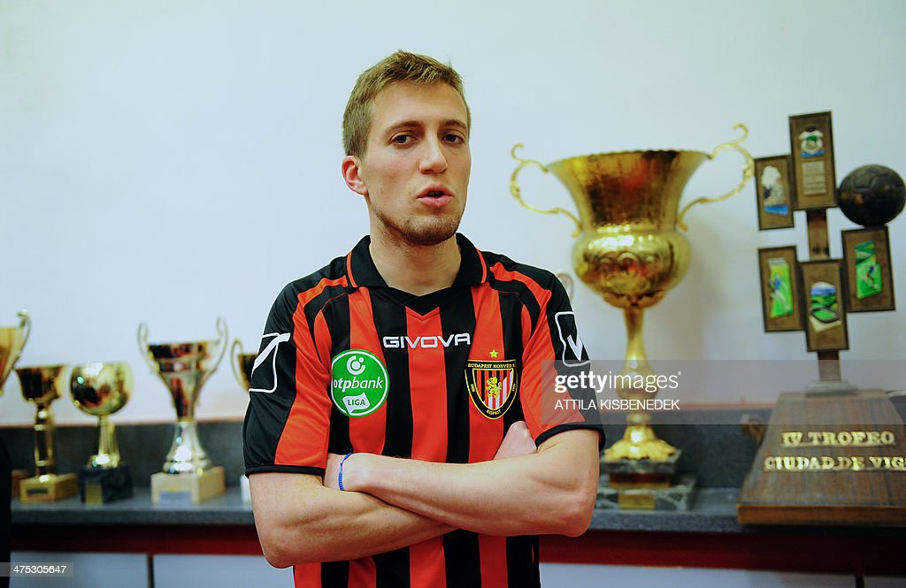 New player of Hungarian football club Budapest Honved Italian striker Arturo Lupoli poses for a picture on February 27, 2014 during their presentation for the press. AFP PHOTO / ATTILA KISBENEDEK
