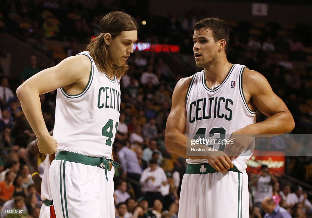New players, forward Kelly Olynyk (#41) and forward Kris Humphries (#43) talked during the first quarter. The Boston Celtics play the Toronto Raptors in the Celtics' first NBA preseason game at TD Garden in Boston, Monday, Oct. 7, 2013.