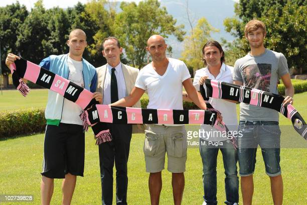 New players of US Citta di Palermo Pajtim Kasami Massimo Maccarone and Nicola Rigoni pose with Vice President Guglielmo Micciche and Team Manager...
