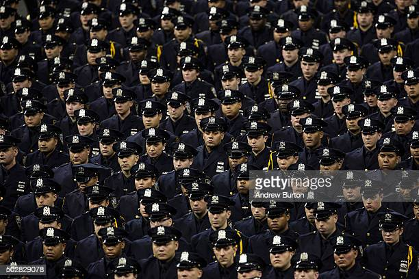 New police recruits attend the New York Police Department graduation ceremony on December 29 2015 at Madison Square Garden in New York City More than...