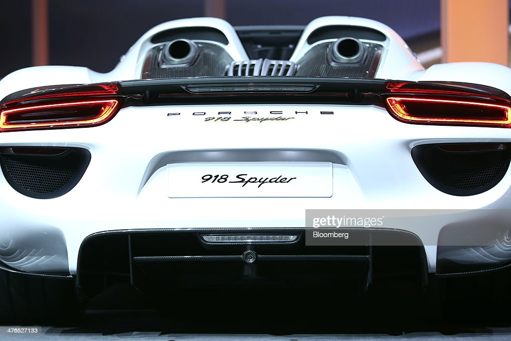 A new Porsche 918 Spyder automobile, produced by Porsche SE, stands on display during a news conference ahead of the opening day of the 84th Geneva International Motor Show in Geneva, Switzerland, on Monday, March 3, 2014. The International Geneva Motor Show will run from Mar. 4, and showcase the latest models from the world's top automakers. Photographer: Chris Ratcliffe/Bloomberg via Getty Images