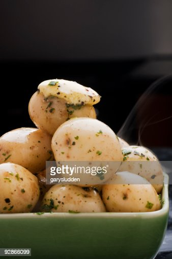 New Potatoes With Herb Butter Stock Photo | Getty Images