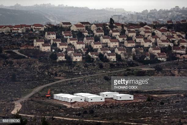 New prefabricated homes are seen under construction in the West Bank between the Israeli outpost of Amona and the Israeli settlement of Ofra north of...
