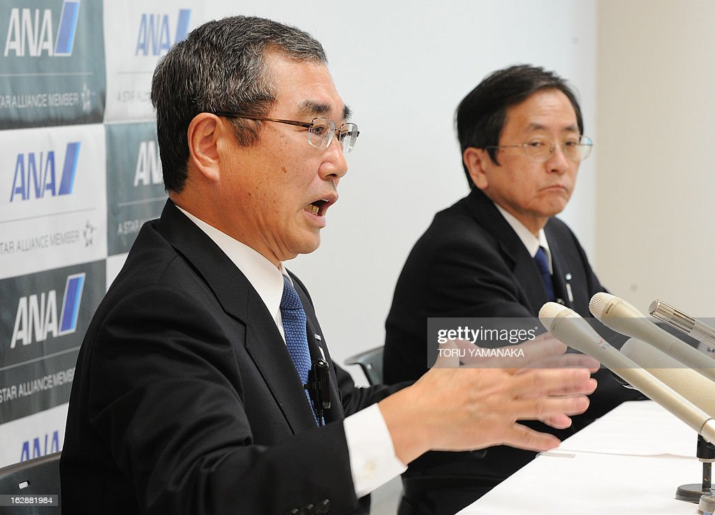 New President and CEO of ANA Holdings Shinichiro Ito (L) gestures as he answers questions next to new President and CEO of ANA Group Osamu Shinobe (R) during a press conference at their headquarters in Tokyo on March 1, 2013. Japan's airlines announced on March 1 a series of management changes reflecting its move to a holding company structure from April 1. AFP PHOTO / Toru YAMANAKA