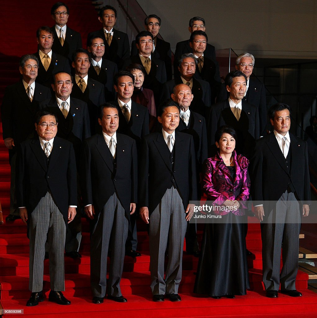 New Prime Minister and President of the ruling Democratic Party of Japan Yukio Hatoyama and his new cabinet members pose at the Prime Minister's...