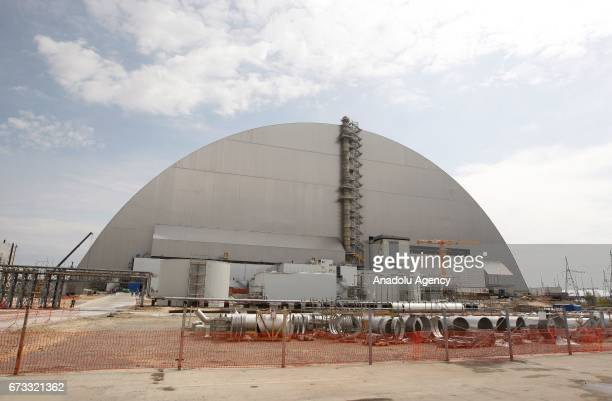 New protective shelter over the nuclear reactor Unit 4 at Chernobyl nuclear power plant is seen during the 31st anniversary of Chernobyl nuclear...