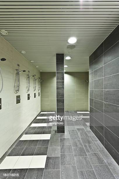 new public bathroom with many showers
