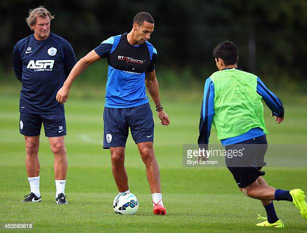 New QPR first team coach Glenn Hoddle watches Rio Ferdinand train during a Queens Park Rangers Training Session on August 14 2014 in Harlington...