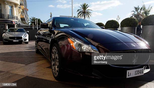 New Quattroporte V8 automobiles produced by Maserati the luxuryauto maker owned by Fiat SpA stand on display during their debut in Nice France on...