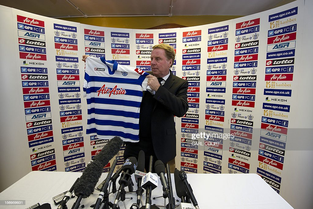 New Queens Park Rangers football club manager Harry Redknapp holds up a team jersey before a press conference in west London on November 26, 2012, to officially announce his appointment. Redknapp has called for an immediate improvement as he takes charge of the Premier League's bottom club for the first time at Sunderland on November 27. Redknapp replaced the sacked Mark Hughes on November 24 and watched from the stands as his new side took the lead at Manchester United later that day, only to fall to a 3-1 defeat.