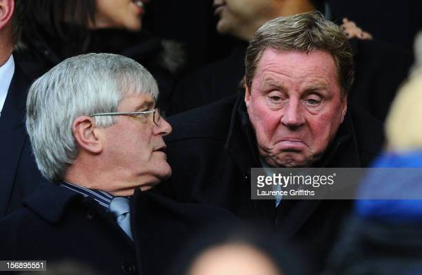 New Queens Park Rangers Manager Harry Redknapp looks on from the stands during the Barclays Premier League match between Manchester United and Queens...