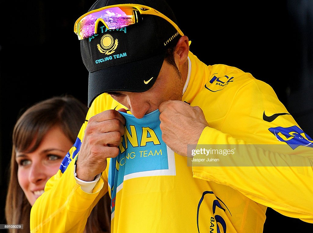 New race leader Alberto Contador of Spain and team Astana kisses the yellow jersey on the podium after winning stage 15 of the 2009 Tour de France from Pontarlier to Verbier on July 19, 2009 in Verbier, Switzerland.
