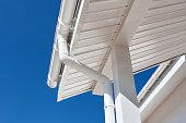 New rain gutter on a home against blue sky