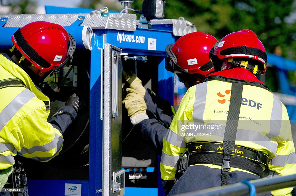 EDF new rapid response nuclear task force (FARN) members take part in a simulation of a nuclear accident at the Avoine nuclear reactor near Chinon, western France, on June 26, 2013. By the end of 2014, the FARN task will be capable of intervening at all the reactors on one EDF site simultaneously in France in an emergency.