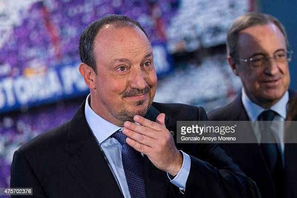 New Real Madrid head coach Rafael Benitez looks on with his eyes wet ahead president Florentino Perez after his presentation at Santiago Bernabeu...