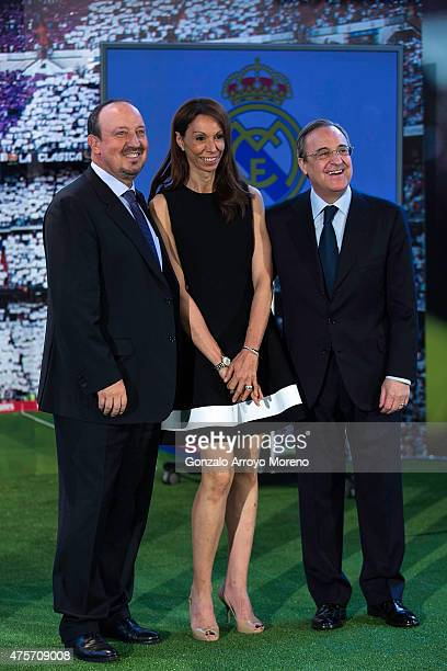 New Real Madrid head coach Rafael Benitez poses for a picture with his wife Montserrat Benitez and president Florentino Perez during his presentation...
