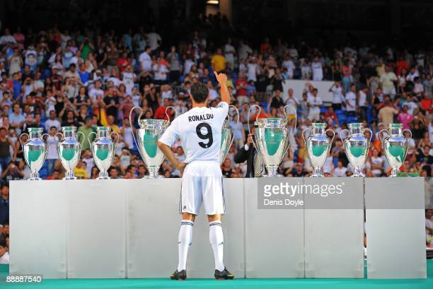 New Real Madrid player Cristiano Ronaldo waves to fans during his presentation at the Santiago Bernabeu stadium on July 6 2009 in Madrid Spain