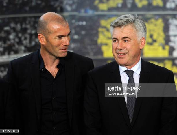 New Real Madrid's Italian coach Carlo Ancelotti poses with Real Madrid's director of football Zinedine Zidane during his presentation at Santiago...