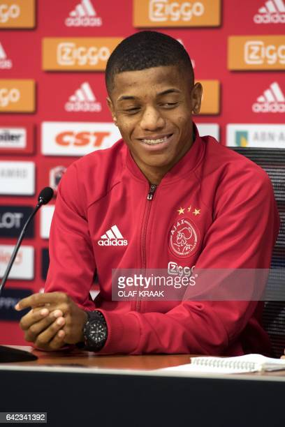 New recruit Ajax Amsterdam Brazilian forward David Neres Campos speaks during a presentation in Amsterdam on February 17 2017 / AFP / ANP / Olaf...