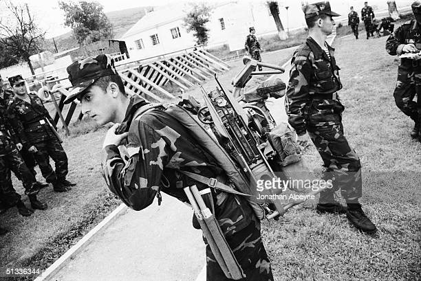 A new recruit in the NKR Defense Army carries a Fagot antitank rocket launchers on his back after intense training May 9 2004 in Stepanakert...