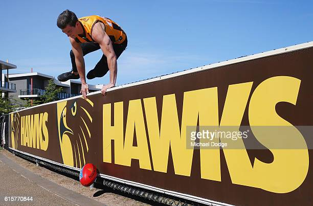 New recruit Jaeger O'Meara ops over the fence after posing during a Hawthorn Hawks AFL media opportunity at Waverley Park on October 20 2016 in...