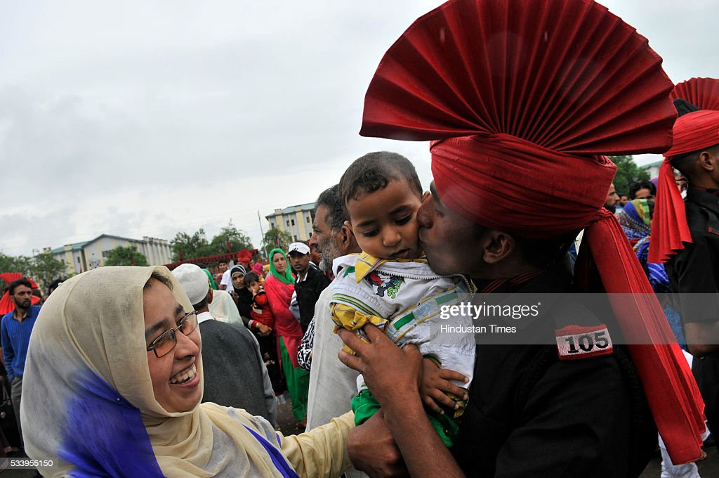 A New recruit of the Jammu Kashmir Light Infantry Regiment (JKLIR) kisses the child after he graduated as an soldier during a passing out parade at an army base on May 24, 2016 near Srinagar, India.249 young men from Jammu & Kashmir were formally inducted into the Army Jammu and Kashmiri Light Infantry Regiment (JKLIR) after nine months of rigorous training.