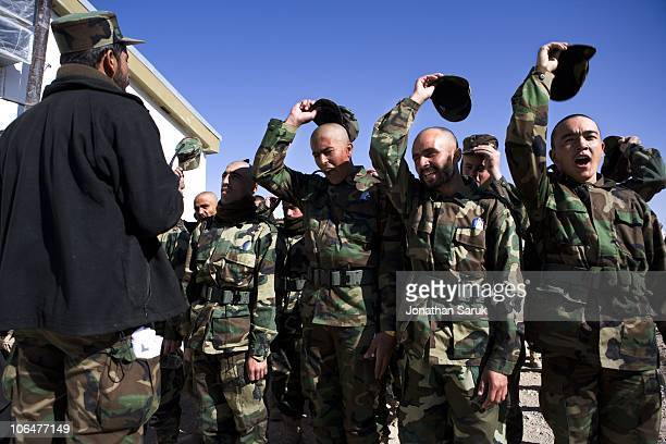 New recruits for the Afghanistan National Army are given instructions before entering the mess hall November 13 2008 at Camp Zafar outside of Herat...