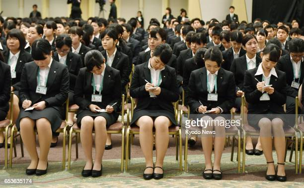 New recruits of 22 group companies of retail giant Seven amp i Holdings Co take notes of President Ryuichi Isaka's words during a welcoming ceremony...