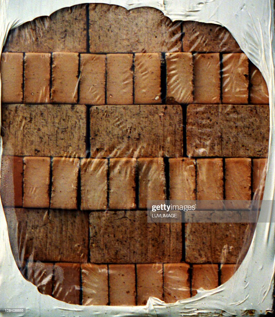new red bricks wrapped in a plastic pile : Stock Photo