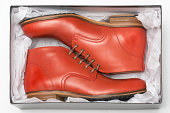 new red shoes in box with wrapping paper