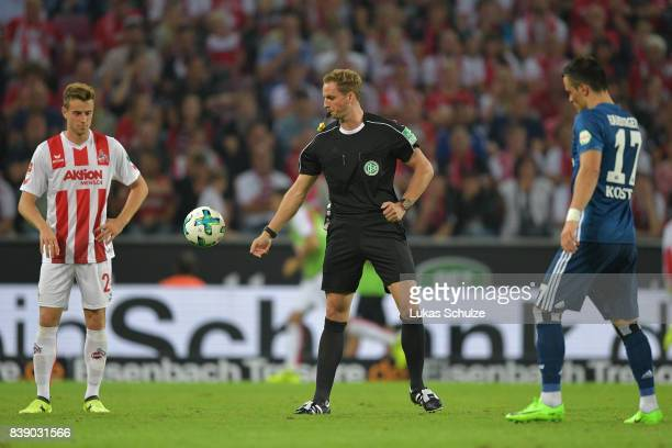 New referee Soeren Storks restart the match during the Bundesliga match between 1 FC Koeln and Hamburger SV at RheinEnergieStadion on August 25 2017...