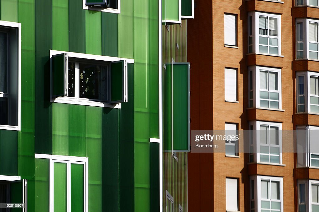 A new residential apartment block stands covered in green cladding beside a brick building in Madrid, Spain, on Monday, Jan. 13, 2014. Spain's rental market is growing as government-spending cuts, a 26 percent jobless rate and subdued mortgage lending make home buying more difficult. Photographer: Angel Navarrete/Bloomberg via Getty Images