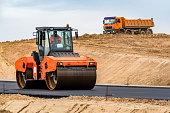 Road roller building the new asphalt road