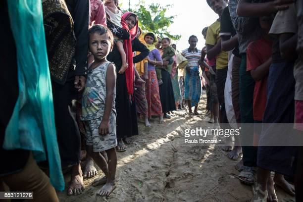 New Rohingya arrivals wait in line for humanitarian food aid from Action Against Hunger mobile emergency support after arriving by foot from Myanmar...