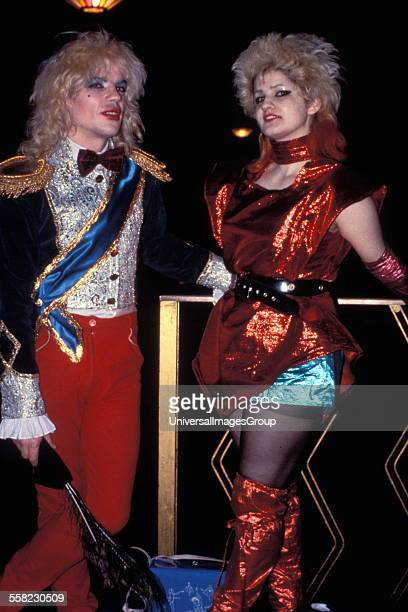 New romantics wearing shiny colourful costumes and bleached white hair UK 1980s