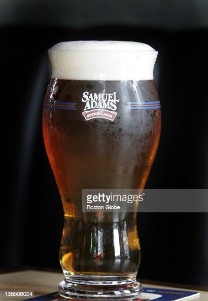 A new Samuel Adams beer glass designed for use with their lager is shown at the Sunset Bar in the Allston neighborhood of Boston Mass on Wednesday...
