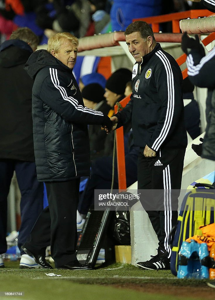 New Scotland management team of Gordon Strachan (L) and assistant manager Mark McGhee (R) congratulate each other after Scotland score the opening goal of the international friendly football match between Scotland and Estonia at Pittodrie Stadium in Aberdeen, northeast Scotland, on February 6, 2013. AFP PHOTO / IAN MACNICOL