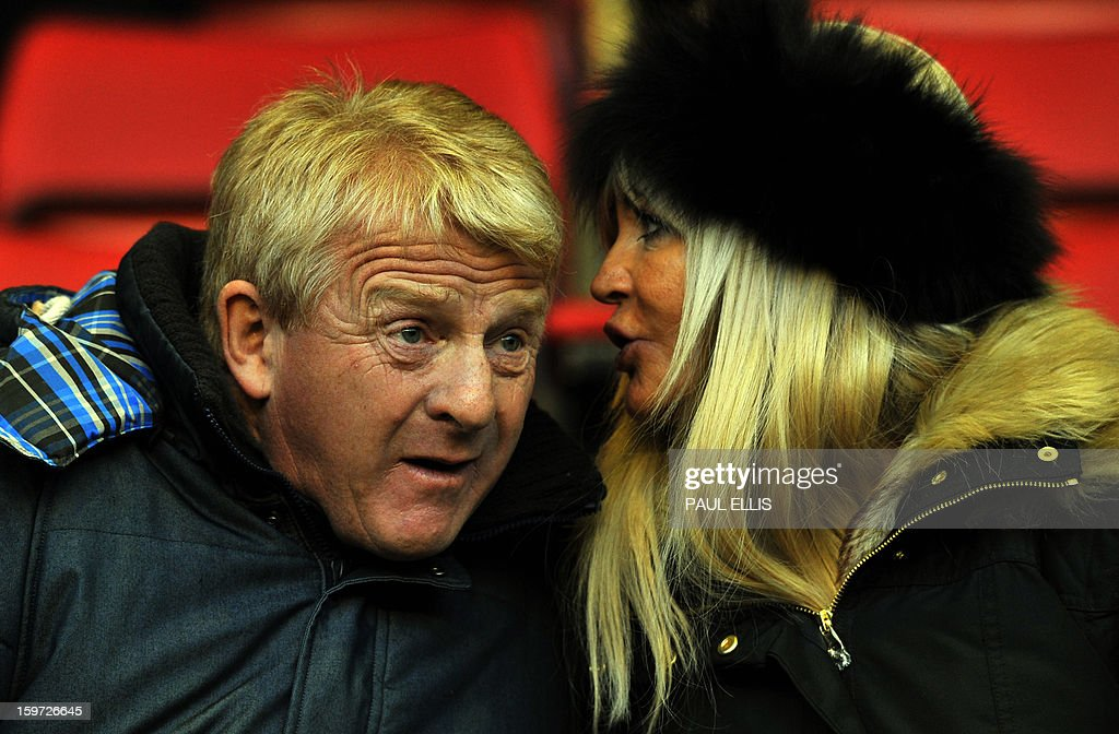 "New Scotland national manager Gordon Strachan (L) takes his seat as he arrives for the English Premier League football match between Liverpool and Norwich at Anfield in Liverpool, north west England, on January 19, 2013. AFP PHOTO/PAUL ELLIS - RESTRICTED TO EDITORIAL USE. No use with unauthorized audio, video, data, fixture lists, club/league logos or ""live"" services. Online in-match use limited to 45 images, no video emulation. No use in betting, games or single club/league/player publications."